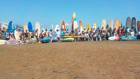People paid tribute to the Dianne crewmen at Agnes Water today by paddling out at Seventeen Seventy on surf boards, kayaks and stand up paddle boards and throwing flowers into the ocean.