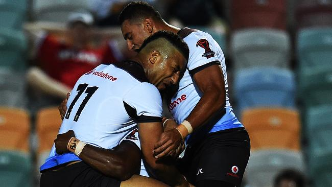 Fiji's Akuila Uate celebrates a try against USA with his teammates. Picture: Zak Simmonds