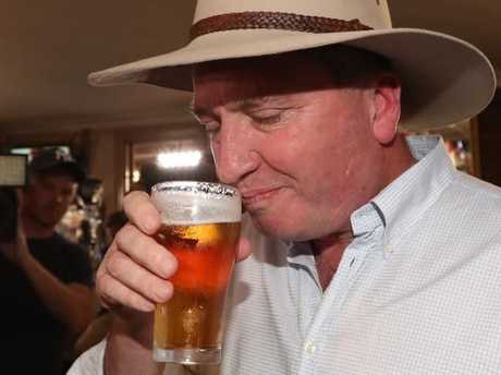 Former Deputy PM Barnaby Joyce begins his re-election campaign talking to locals — and enjoying a cold one — at a pub in Tamworth just a few hours after yesterday's High Court decision. Picture: Lyndon Mechielsen/The Australian
