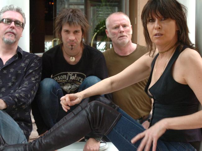 The Pretenders with lead singer Chrissie Hynde, Martin Chambers (glasses), Nick Wilkinson (black T) and Adam Seymour (green T).