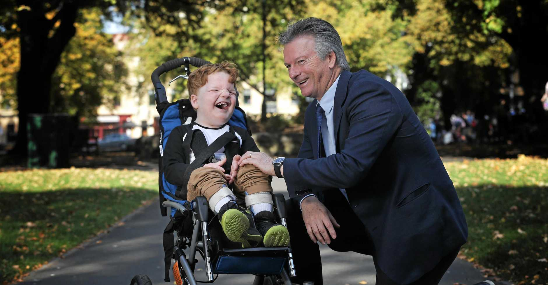 Former Australian cricket captain Steve Waugh with Xavier Kitchin, 5 of Scottsdale. Xavier is one of several Tasmanian recipient of a grant from the Steve Waugh Foundation. Picture: LUKE BOWDEN