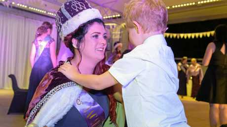 Newly announced Jacaranda Queen Alana Gordon gets a hug from her son as she walks off stage.