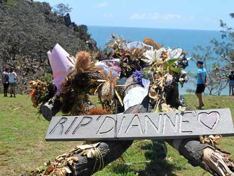 TRIBUTE: Messages, flowers and ornaments have been placed at a memorial at the Seventeen Seventy headland.