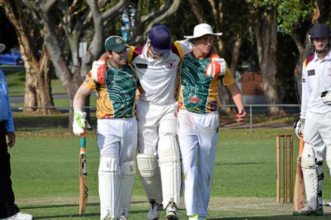 CAUGHT OUT: Alstonville all-rounder Jason Caught has to be helped from the field by Cudgen players after injuring his hamstring.