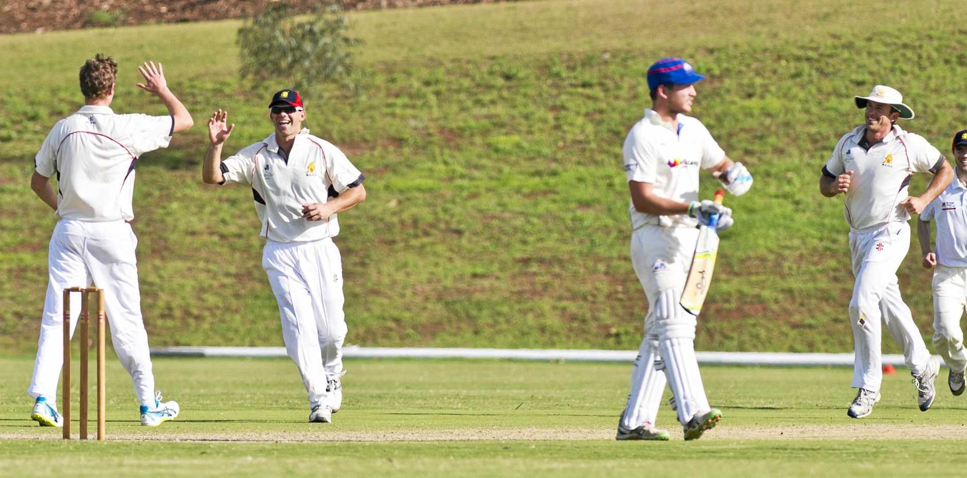 Metropolitan-Easts co-captain Peter Reimers celebrates catching out Highfields Railways' Simon Schmotz during their Harding-Madsen Shield match at the weekend.
