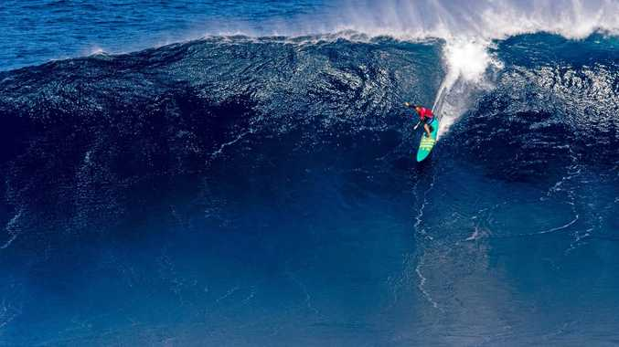 SCARY RIDE: Paige Alms of Hawaii wins the women's 2017 WSL Pe'ahi Challenge.