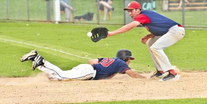 SAFE: Bulldogs' Jimmy Laird safely dives back to first base under the watchful eye of Rangers' Brenton Althaus.