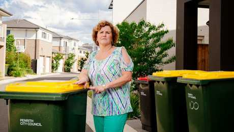 Anne Marshall, 59, from Thornton, has to wheel her bins from Cannonball Lane to William Hart Crescent for them to be collected. Developers are building cramped housing estates with streets too narrow to fit garbage trucks. Picture: Jonathan Ng
