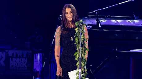 Chester Bennington's wife Talinda reads a speech during the concert. Picture: Christopher Polk / Getty Images.