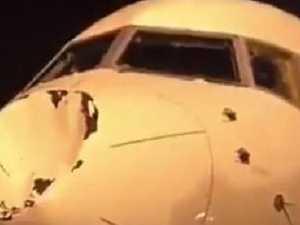 Damaged plane's massive dent explained
