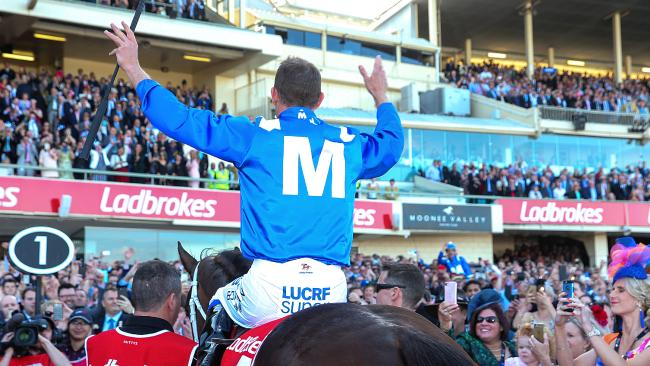 Hugh Bowman returns to scale after the mighty win. Picture: Ian Currie