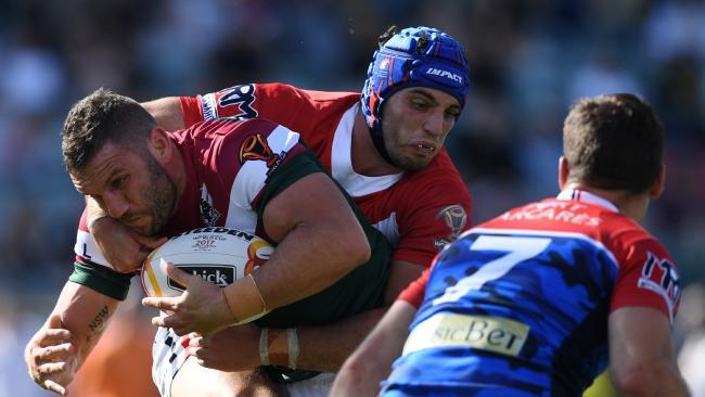 Lebanon captain Robbie Farah is hit by Benjamin Jullien of France.