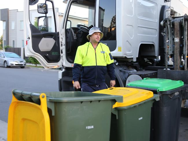 Garbage truck driver Michael Roebuck tries to make his rounds of new housing estate Thornton Project in Penrith. Picture: John Grainger