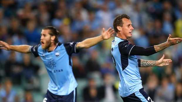 Josh Brillante and Luke Wilkshire appeal for a hand ball against Perth Glory. Picture: Getty Images
