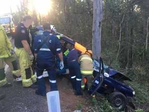 Man trapped in car, airlifted to hospital
