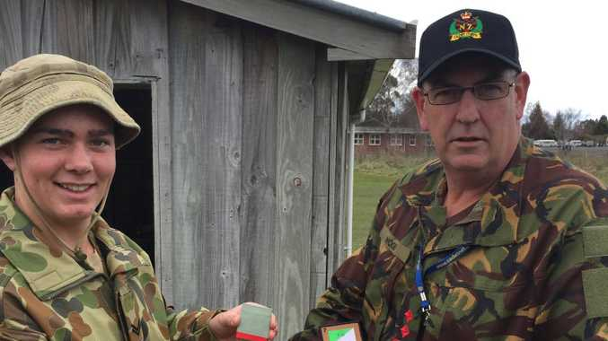 BUILDING BRIDGES: Toowoomba Australian Army Cadet Corporal Kodi Delaney-Leach exchanges badges with an instructor from the New Zealand Army Cadets during his recent visit to New Zealand as part of the Australian team in the New Zealand Chief of Army's Cadet challenge.