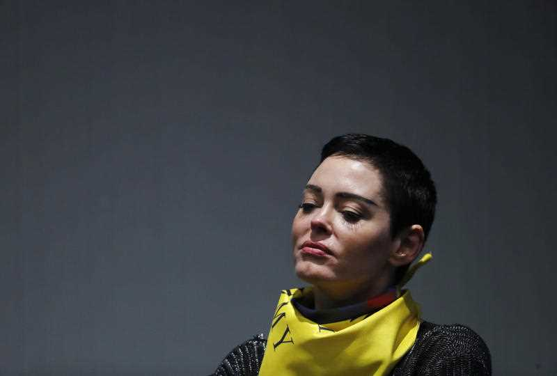Actress Rose McGowan speaks on a panel at the inaugural Women's Convention in Detroit, Friday, Oct. 27, 2017. McGowan recently went public with her allegation that film company co-founder Harvey Weinstein raped her.