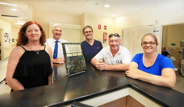 BIG HEARTS: Family and friends hand over $5300 to the Tweed Hospital Dialysis Unit which cared for local school aide Nikki Collis. Pictured here are Annette Duffy, Alistair Thomson, Andrew Gosling, Peter Jeffree and Nikki Collis.