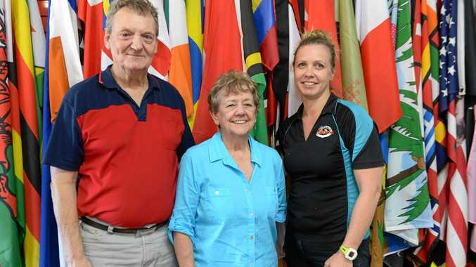 Gina's Flags owners Graeme and Gina Davis with Sabine De Groot at their Evans Avenue shop.
