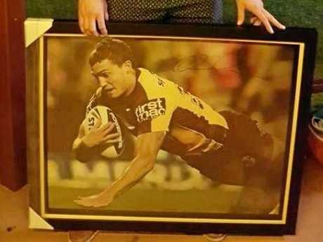 Baralaba boy Corey Oates donated a signed photo to his local pub, Baralaba Hotel.