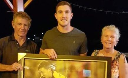 Corey Oates donates a signed photograph to owners of his hometown pub, John and Jane Bidgood.