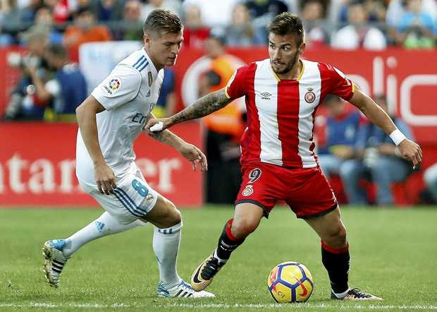 Girona forward Portu (right) scored one of the two goals in the 2-1 win over Real Madrid.