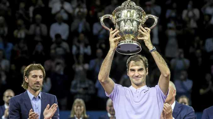 Roger Federer lifts the Swiss Indoors trophy after defeating Juan Martin Del Potro.
