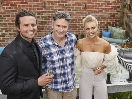 'It's a bargain!' ... Hughesy with Josh and Elyse after purchasing their home.