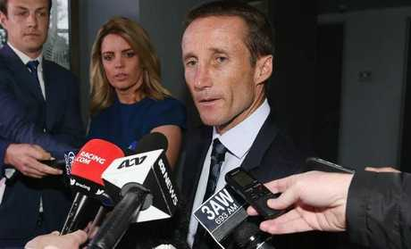 Damien Oliver looks dejected after his appeal against his 20 meetings suspension handed out after his Cox plate ride was dismissed. Picture: Getty Images
