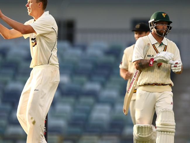 Matthew Wade (R) trudges off after being dismissed cheaply.