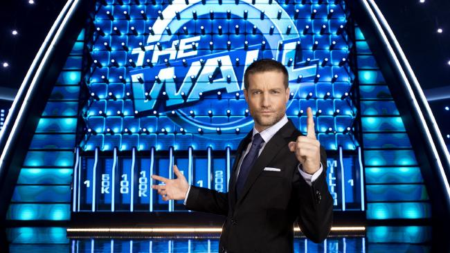 Axle Whitehead hosts Seven's new game show, The  Wall.