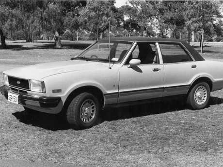 Ford Cortina Ghia motor car in the golf links in the parklands, North Adelaide, 18 Jan 1978.