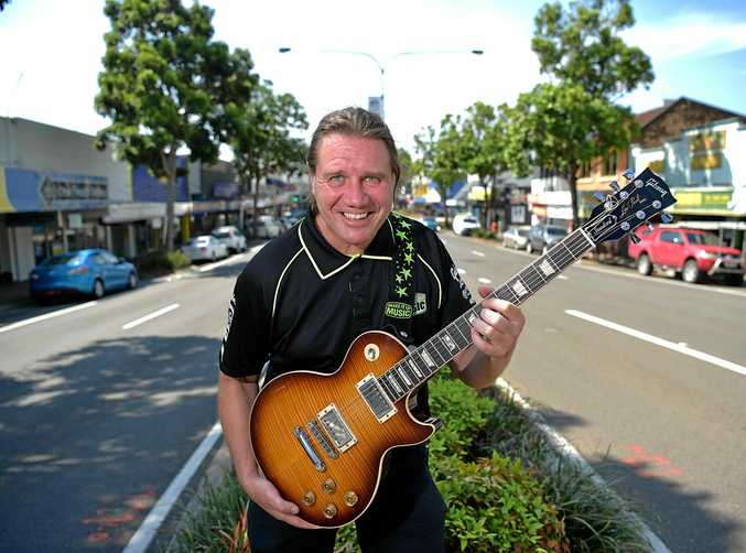 Will Nambour develop as a centre for music with plans to locate USC's Communication and Creative Arts School in the town and potentially at the council chambers.Mark Higgins from Shake It Up Music rocking out in Nambour's main street.