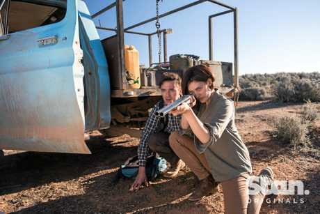 Rebecca (Tess Haubrich) and Brian (Matt Day) in a fight for survival in Wolf Creek Season 2.