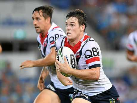 Luke Keary (right) and halves partner Mitchell Pearce on the charge for the Roosters.
