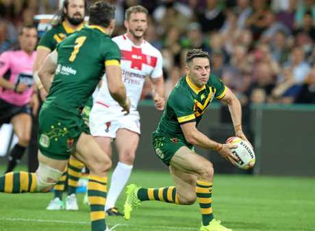 Cooper Cronk in action for Australia during the World Cup between clash against England.