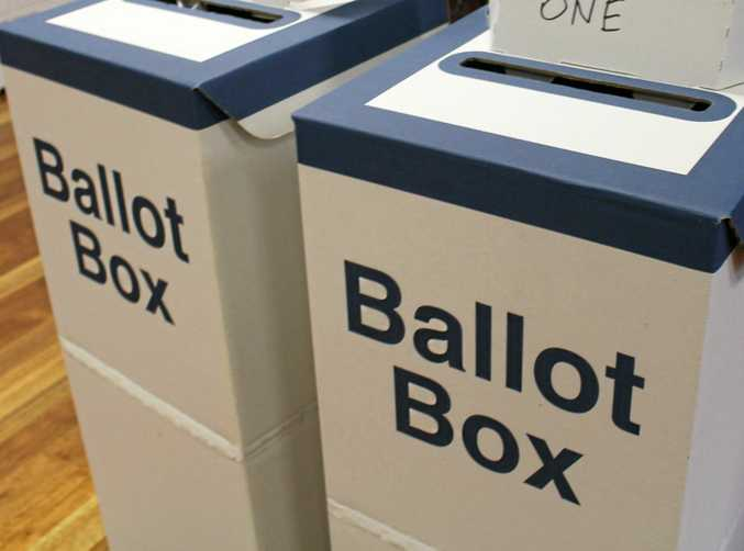 Two ballot boxes stand at each polling booth for voters to cast their ballots on election day.
