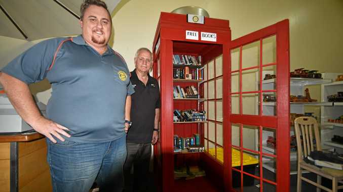 COME INSIDE: Ian Leven of Casino Rotary and Pastor Pete Boughey of Toys Change Lives with the London booth library that houses Casino's Little Free Library Book Exchange.