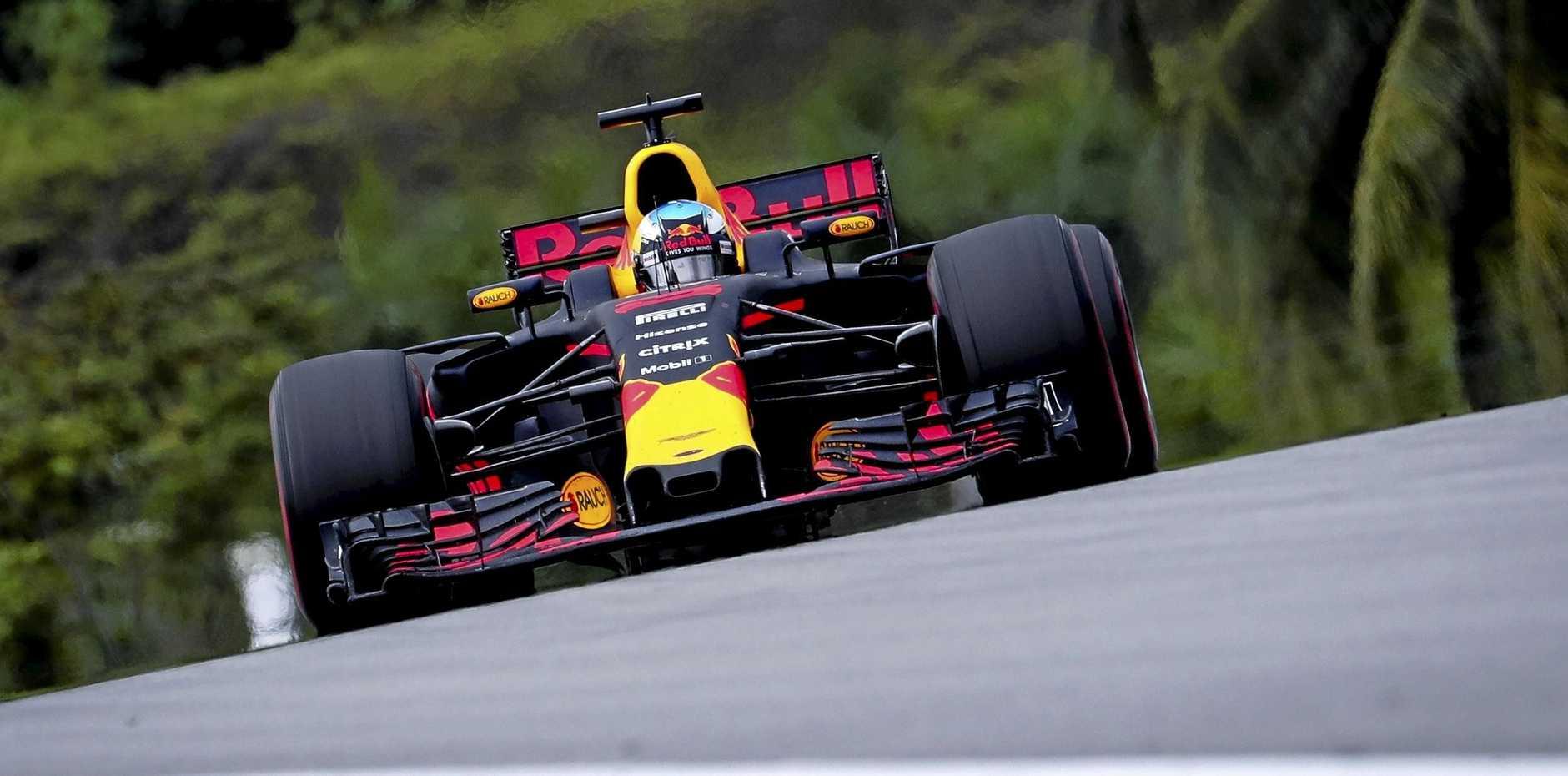 Australian Formula One driver Daniel Ricciardo guides the Red Bull Racing car around the Malaysian circuit.