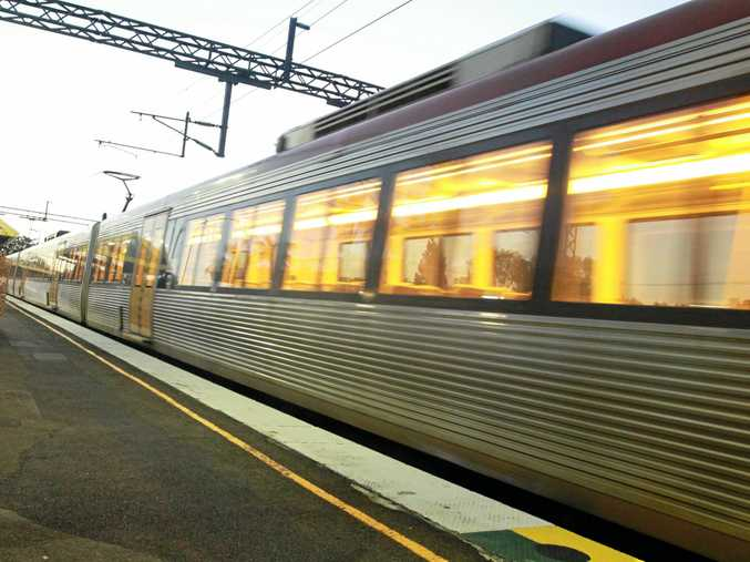 A train from Brisbane arrives at the Nambour Railway Station.