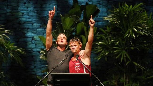 Cairns Regional Council has hosted a reflection ceremony for all the citizens of Cairns to pay their respects to the dead and missing crew of the fishing trawler Dianne. The ceremony was held at Munro Martin Parklands on Tuesday evening. (L-R) Surviving crew member of the Dianne Ruben McDornan and the second skipper Adam Kelly raise their hands in the air as a sign of respect for their lost and d