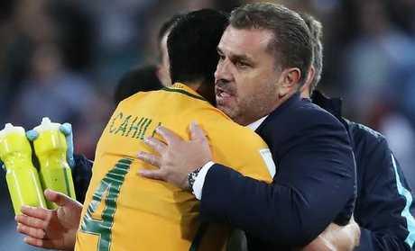 Socceroos coach Ange Postecoglou celebrates with Tim Cahill. Picture: Brett Costello