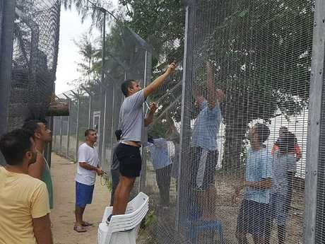 Refugees securing a recently damaged perimeter fence at the Manus Island immigration detention centre in Papua New Guinea on Monday, October 30. Picture: Refugee Action Coalition/AAP