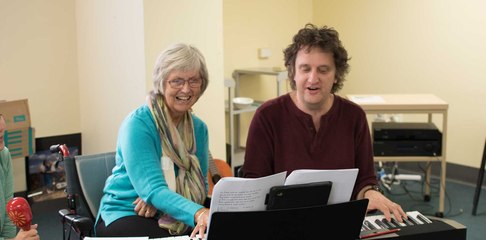 CREATIVE HEALTH: Musician Pete McDonald teaching a participant to play piano during an Arts on Prescription music program.