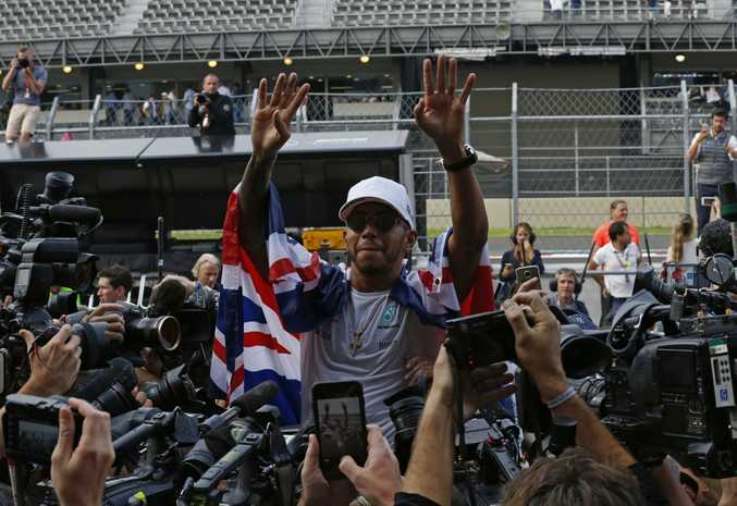 Mercedes driver Lewis Hamilton, of Britain, celebrates after the Mexican Grand Prix.