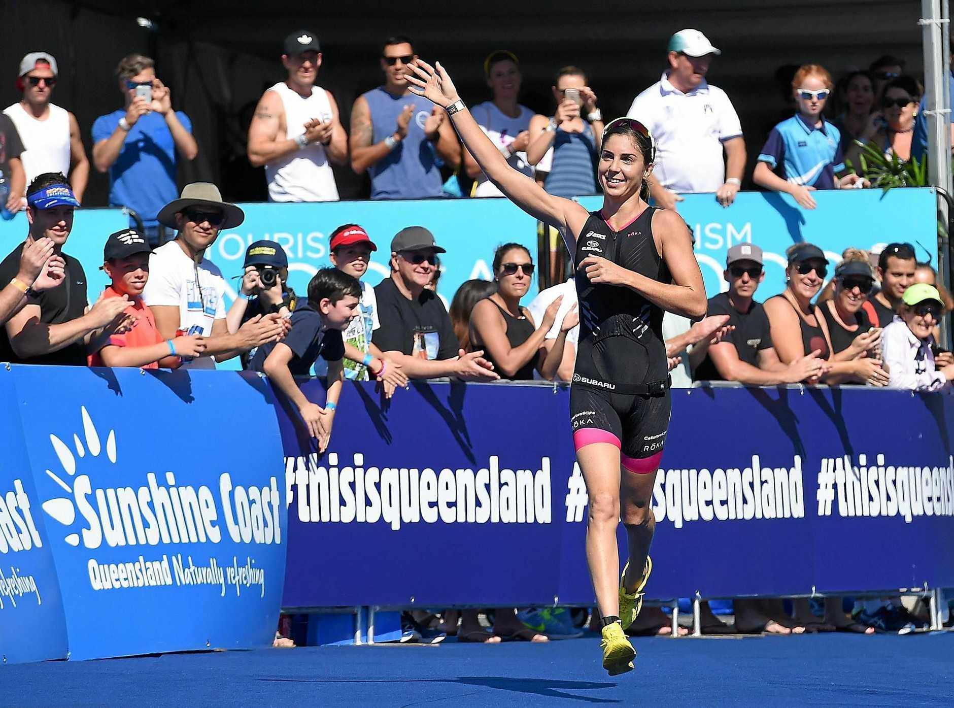 GENTLE DOES IT: Ashleigh Gentle celebrates winning the Noosa Triathlon in 2016. This year's Noosa Triathlon Multi-Sport Festival runs across this weekend.