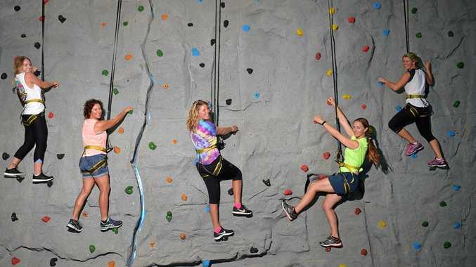HIGH HOPES: Alice Ross, Jodi Atfield, Hannah Lambert, Robyn Leape and Caitylin Jones on the rock wall at Currimundi Recreational Camp.