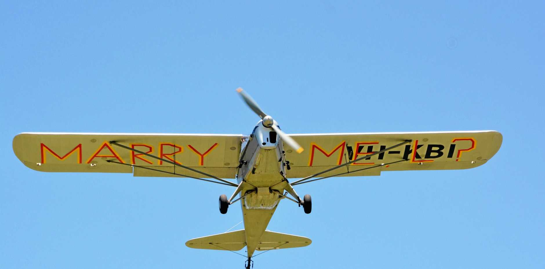 HEART WARMING: Gatton's Phil MacMahon popped the question to Kerri Beasley with duct tape on his plane. (re-enactment).