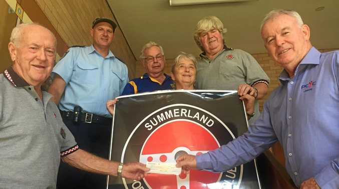 SUMMERLAND Car Club's Bryan White (left) presents a cheque to Mark Greig from PCYC's Learner Driver program, while Snr Const Lachlan Bransgrove, Geoff Jacobs from Barlows and club members Fiona and David Gordon look on.