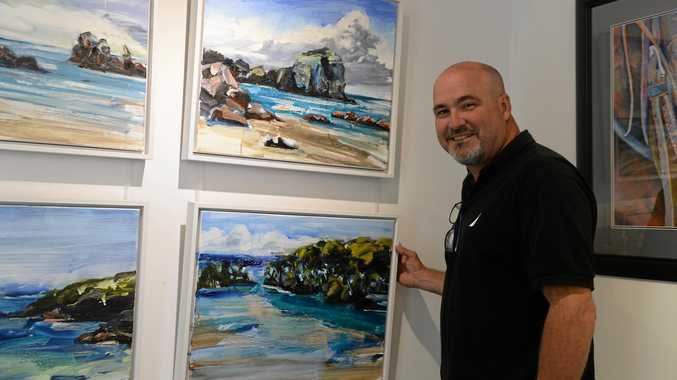CELEBRATION: Bradley Short with some of Tim Allen's work at Milton House Gallery at Milton Picture Framers, which is celebrating its 25th anniversary this year.